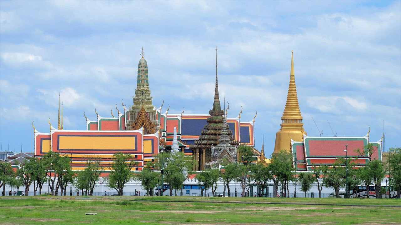 Grand Palace and Prakaew temple at Thailand Architecture Building Exterior Built Structure Day Grand Palace Grand Palace Bangkok Thailand Grass Nature No People Outdoors Religion Sky Spirituality The Architect - 2017 EyeEm Awards Travel Destinations Tree