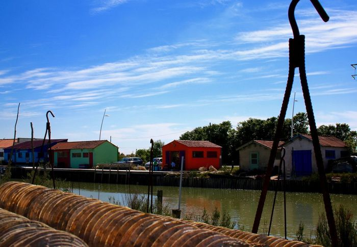 EyEmNewHere EyeEm Best Shots EyeEm Gallery EyeEm Best Edits Beauty In Nature Ile D'Oleron Alternative Energy Architecture Building Exterior Built Structure Cloud - Sky Colors Houses Day Nautical Vessel No People Oil Pump Outdoors Sky Windmill