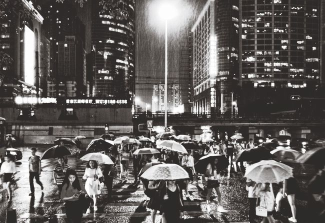 The rainy night My Street Photography My Traveling Photography From My Point Of View Streetphotography Nightphotography Rainy Rainy Night Real People Large Group Of People Built Structure City Life Umbrella Streetphotography_bw Blackandwhite Black & White