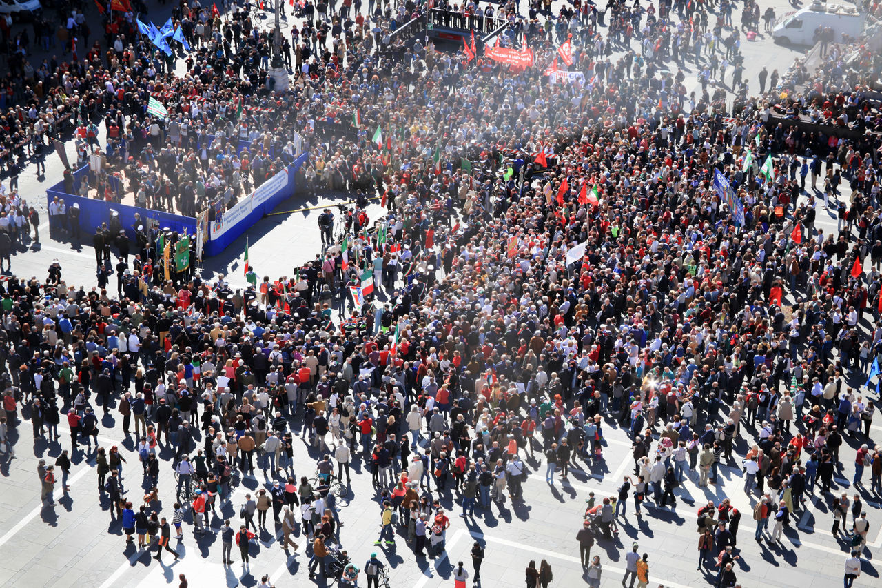 Peopl crowd at Duomo square during April 25 Liberation day celebrations in Milano, Italy. View from Duomo cathedral. 25 Aprile Celebration City Life Crowd Enjoyment Fun Large Group Of People Milano Outdoors