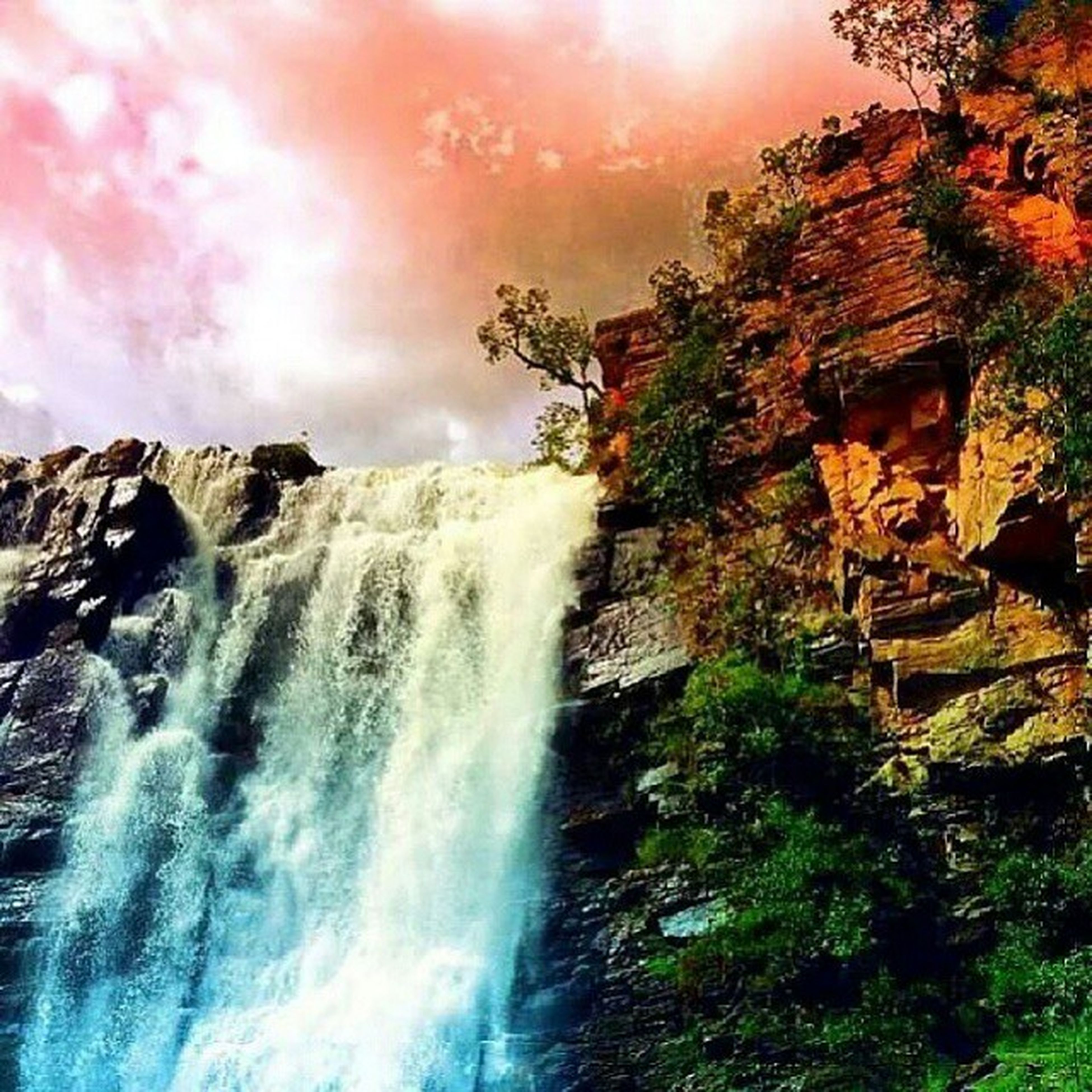 water, scenics, beauty in nature, rock - object, nature, waterfall, tree, sky, flowing water, tranquil scene, motion, rock formation, tranquility, long exposure, idyllic, growth, flowing, cloud - sky, plant, outdoors
