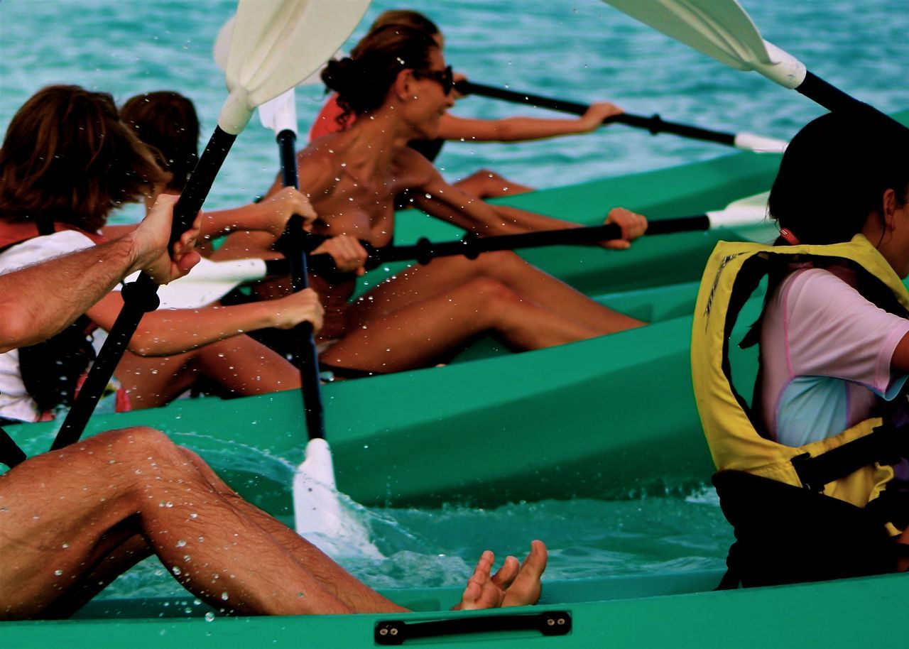 Active Beach Blue Colorful Full Frame Green In Motion Kayak Leisure Activity Lifestyles Medium Group Of People Ocean Paddleboarding Photography In Motion Race Sea Sitting Summer The Color Of Sport The Way Forward Togetherness Watersports Splashing