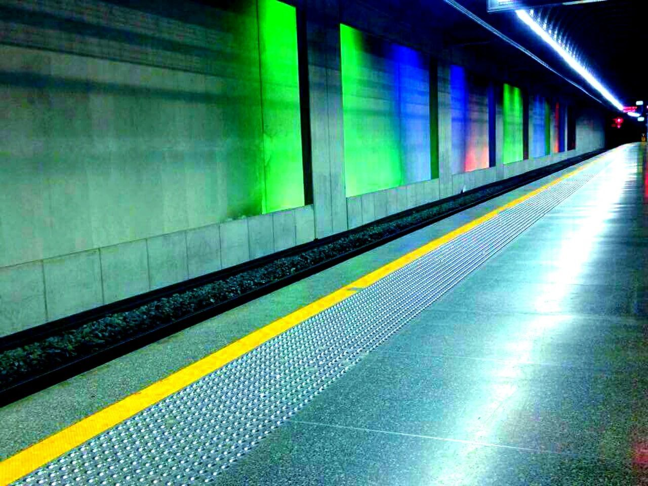 illuminated, subway station, transportation, speed, railroad track, multi colored, station, indoors, night, subway train, no people, architecture, technology, neon, city