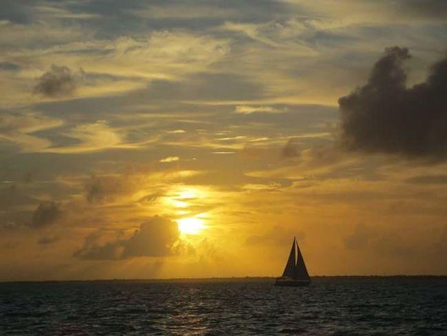 Last sunset of 2015 Last Sunset 2015  Goodbye Setting Sun Orange Sky Beach Photography Sailboat Gorgeous_sunsets Record Highs