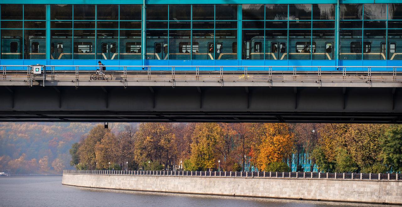 Railway Bridge Over River During Autumn