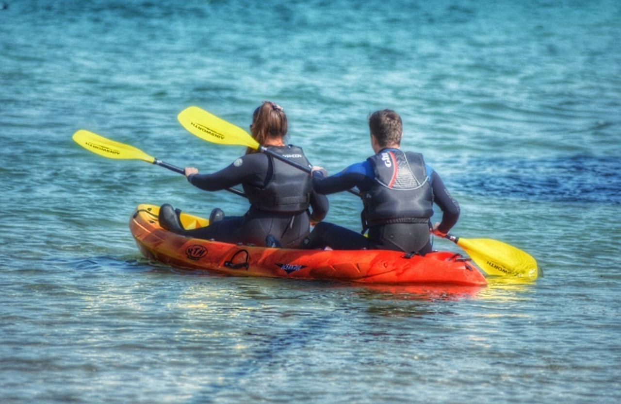 two people, togetherness, adventure, leisure activity, oar, kayak, water, real people, life jacket, sea, waterfront, men, lifestyles, day, women, outdoors, vacations, challenge, teamwork, friendship, bonding, full length, nautical vessel, nature, extreme sports, adult, people, young adult, adults only