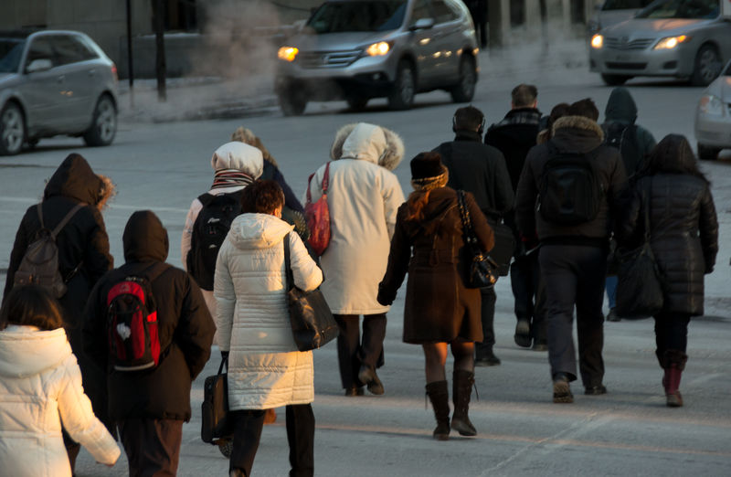People walking in the street in a very cold morning in Montreal Casual Clothing City City Life Cold Lifestyles Person Real People Selective Focus Streetphotography Sunrise Unrecognizable Person Urban Urban Life Very Cold Morning Walking Workers