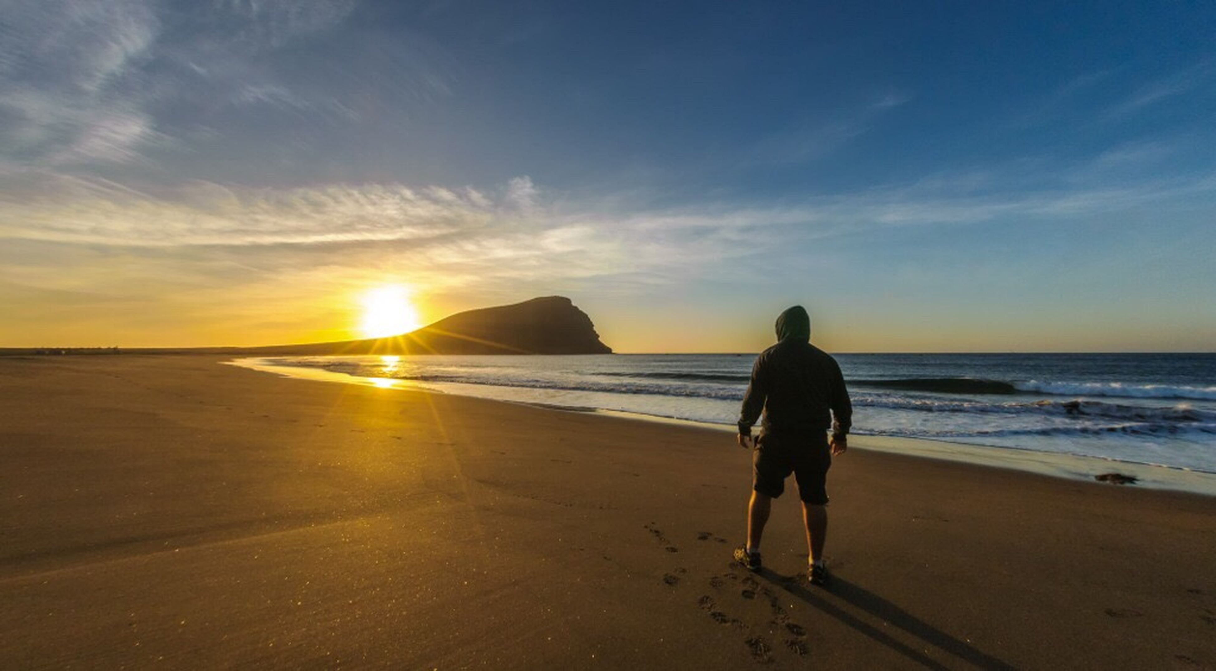 sea, beach, sand, sunset, rear view, sky, sun, beauty in nature, nature, horizon over water, full length, outdoors, people, one person, adult, silhouette, cloud - sky, vacations, scenics, adults only, only men, one man only, day