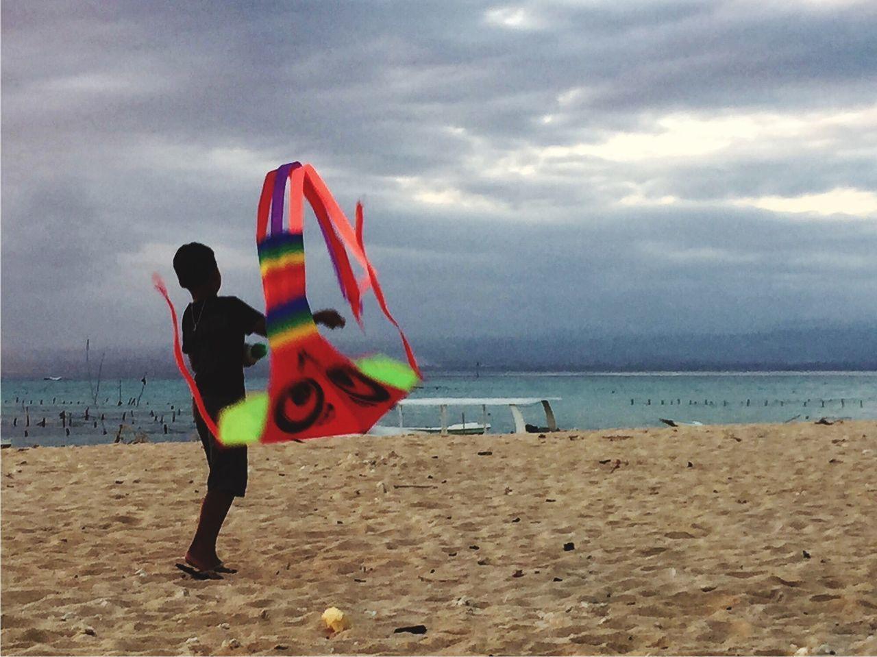 EyeEmNewHere INDONESIA Nusa Lembongan Beach Beach Fun Boy Motion Motion Blur Kite Flying Kite Rainbow