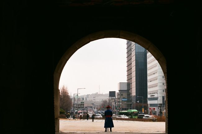 Traditional Day Lifestyles City One Person Walking Building Exterior Men Arch Architecture Built Structure Real People X700 Minolta X700 Minolta Film Photography Korean Traditional Architecture Namdaemun Namdaemun Market 남대문 숭례문