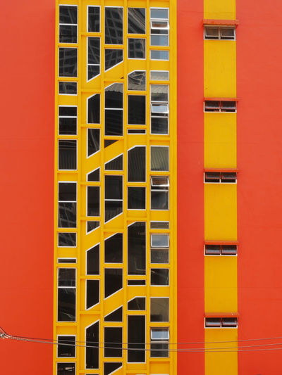 Apartment Architecture Backgrounds Bright Colors Bright_and_bold Building Built Structure City Colour Of Life Day Façade Full Frame In A Row No People Orange Color Outdoors Repetition Residential Building Residential Structure Tall - High Vivdcolours Vivid Color PaletteYellow Yellow Color