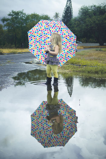 Enjoy The New Normal Playing In Puddles Playing In The Rain Child Childhood One Person Outdoors Rainy Days Toddler  Umbrella Autumn Adventure Fun Puddle Jumping Reflection Reflections In The Water Kids Being Kids Cute Adorable Dreary Weather  Parking Lot Nature Beauty In Nature Beautiful Sunshine On A Rainy Day