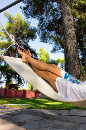 Relaxing on the swing. Relaxing Shadows & Lights Swinging Barefoot Enjoy Female Legs Hammock Legs In The Air Leisure Activity Pretty Relaxation Resting Resting Time Swing Women's Legs