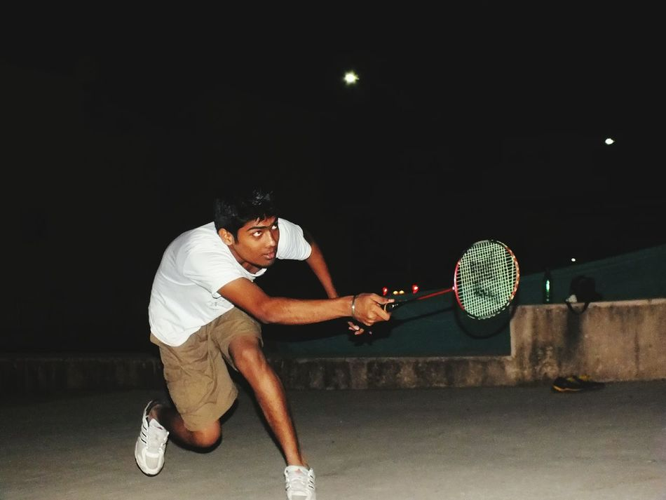 The Color Of Sport Night Boys Weekend Activities Badminton Picnic Night Out MumbaiDiaries New Place Night Full Length Boys Casual Clothing Holding Illuminated Person Innocence In Front Of Young Adult