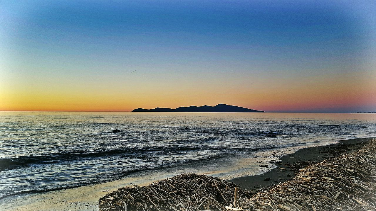 Sunset Sea Sky Horizon Over Water Beauty In Nature Water Beach Nature Scenics Outdoors Tranquility No People Tranquil Scene Clear Sky Day