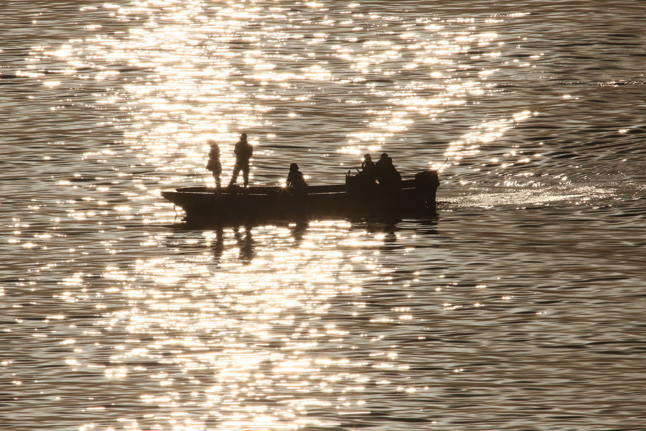 water, silhouette, waterfront, sunset, nautical vessel, transportation, reflection, nature, mode of transport, real people, rippled, tranquility, men, beauty in nature, outdoors, sea, scenics, rowing, day, people
