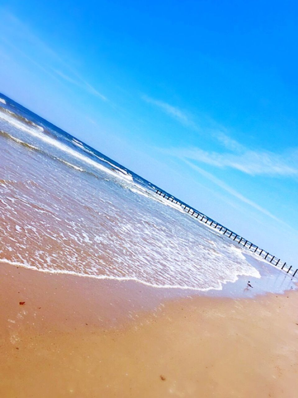 beach, sea, water, sand, nature, beauty in nature, shore, scenics, tranquil scene, outdoors, no people, tranquility, day, horizon over water, blue, wave, sky