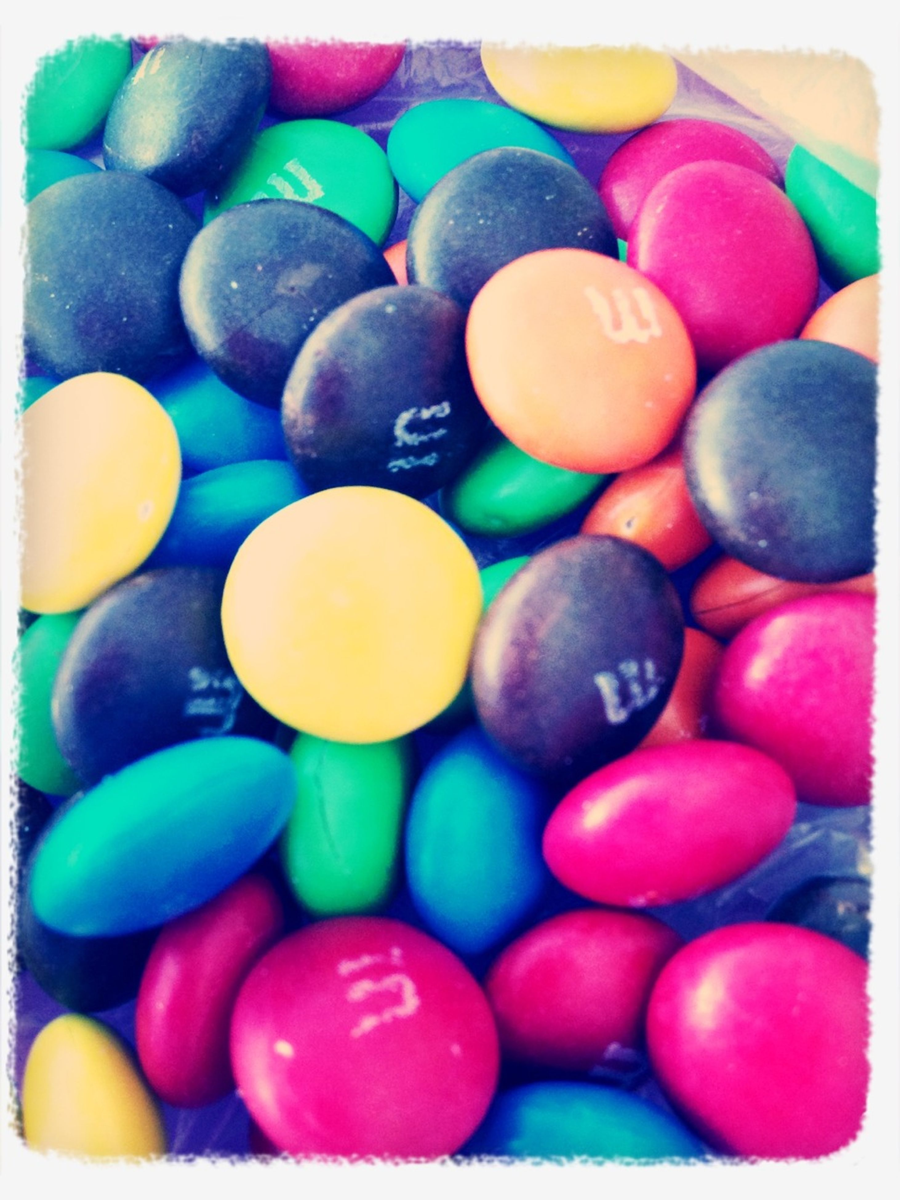 multi colored, large group of objects, variation, abundance, transfer print, colorful, indoors, still life, sweet food, full frame, auto post production filter, choice, backgrounds, candy, food and drink, arrangement, close-up, high angle view, food, balloon