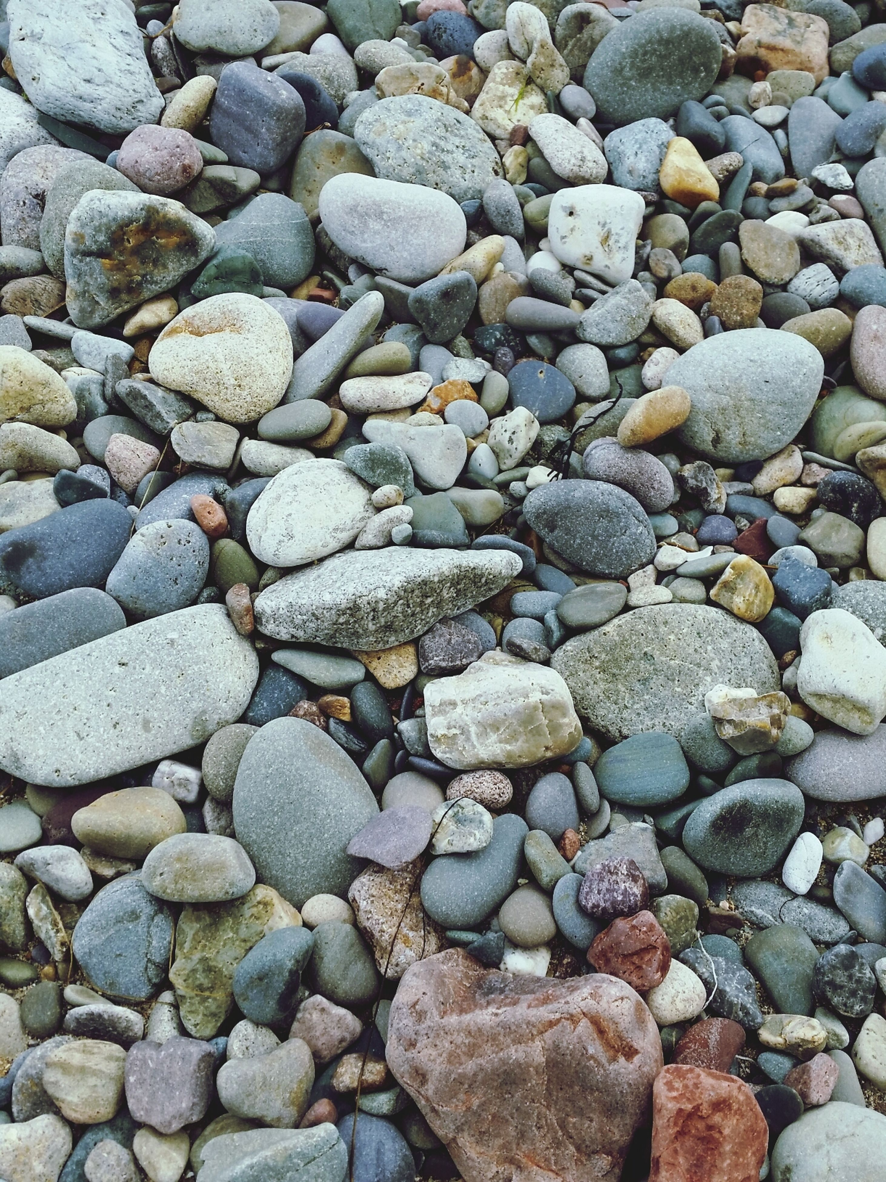 stone - object, pebble, rock - object, abundance, stone, textured, backgrounds, full frame, large group of objects, high angle view, nature, rock, day, outdoors, no people, rough, beach, tranquility, close-up, pattern