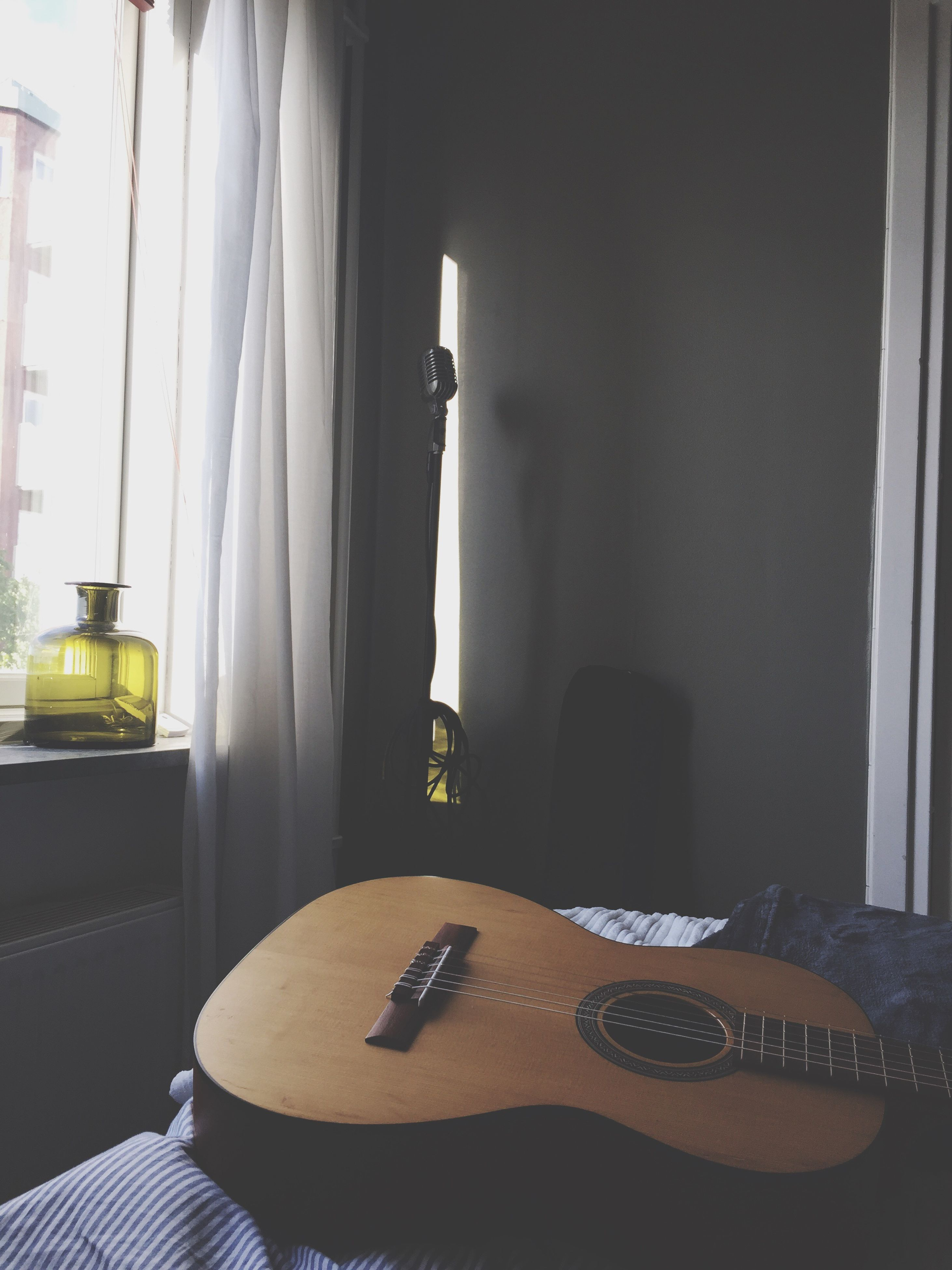 indoors, table, home interior, window, no people, day, technology, guitar