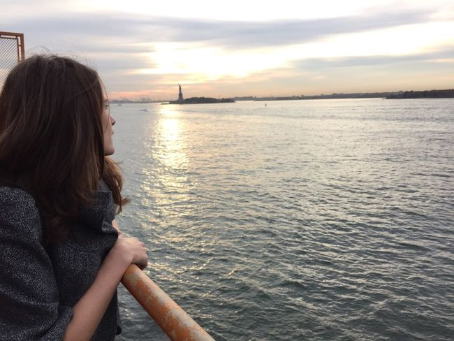Staten Island Ferry Statue Of Liberty Looking Out City Escape Tourist Sunset Water On The Way