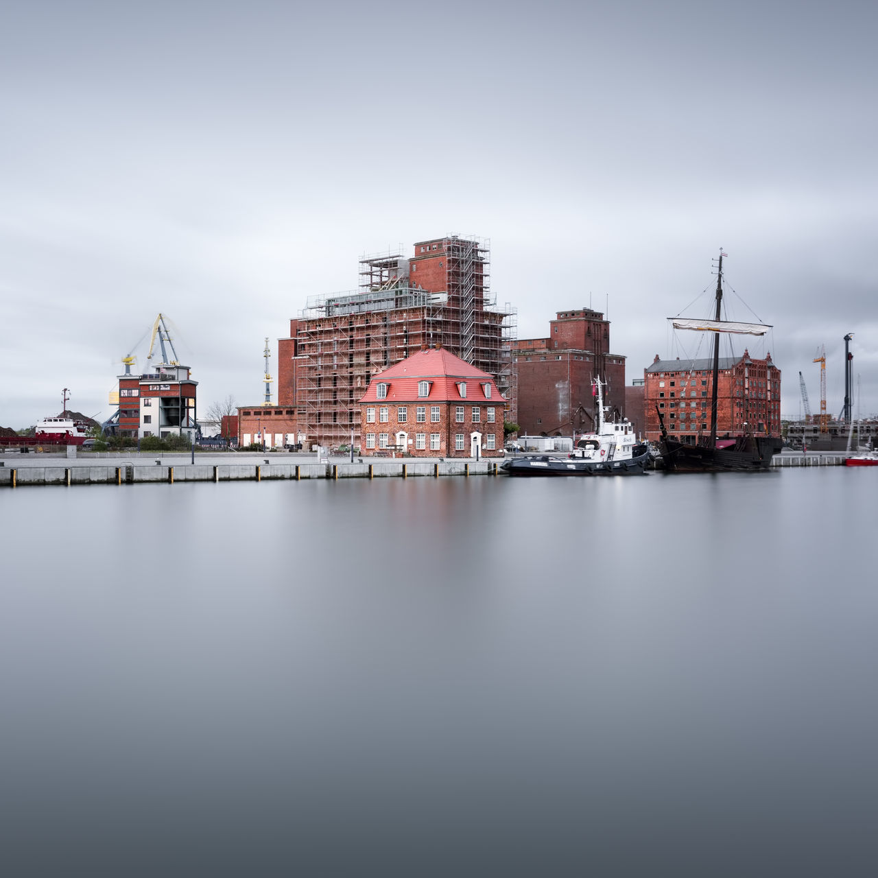 wismar harbor against clear sky Architecture Baltic Sea Building Exterior Built Structure City Cityscape Day Fine Art Harbor View Long Exposure Mecklenburg-Vorpommern Muted Colors No People Ocean Outdoors Philipp Dase Reflection Sky Urban Skyline Water Wismar Wismar Harbor Wismarhafen