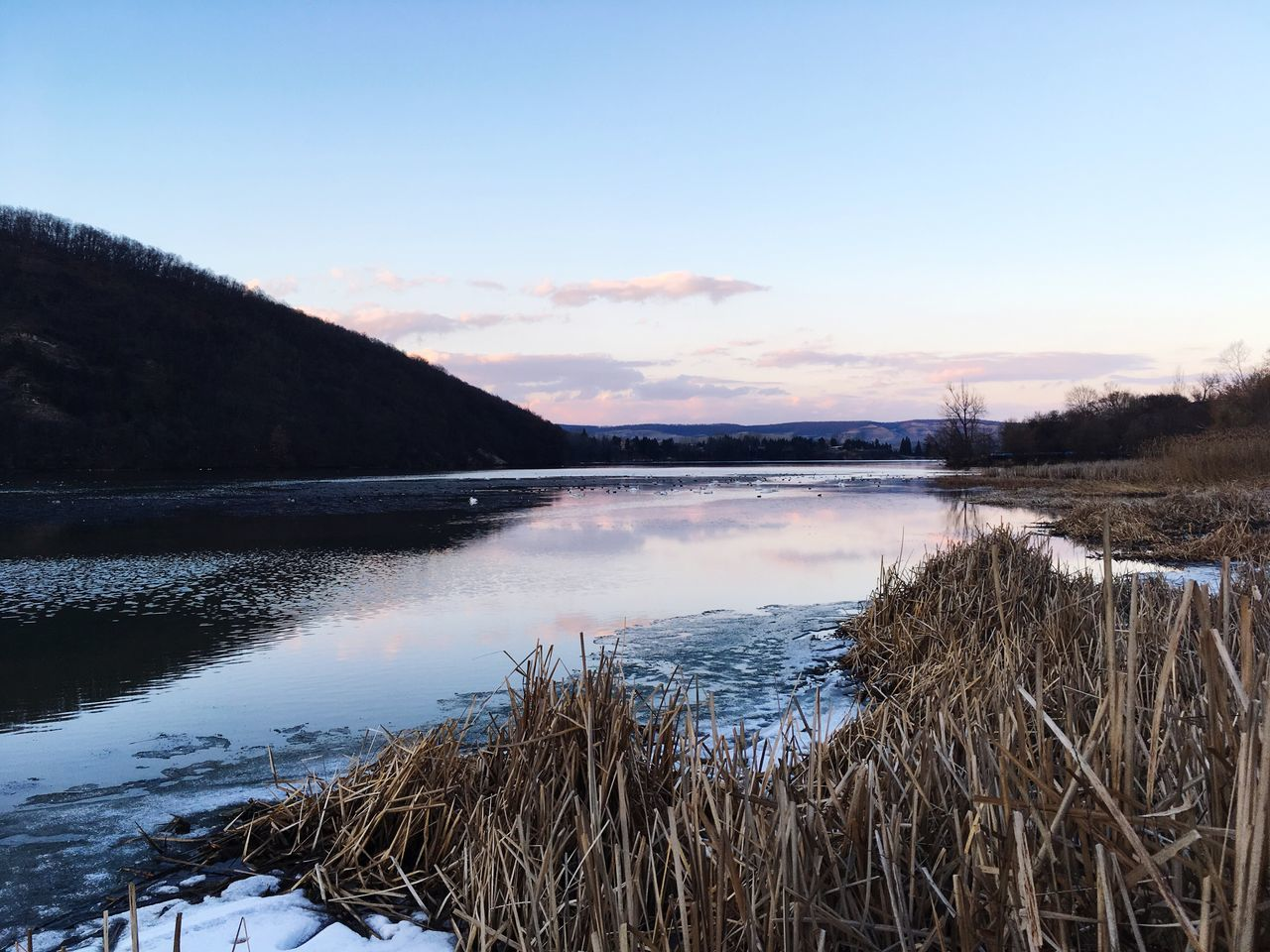 nature, tranquil scene, tranquility, scenics, water, beauty in nature, sky, outdoors, no people, lake, winter, mountain, snow, day, cold temperature, sunset, landscape, tree