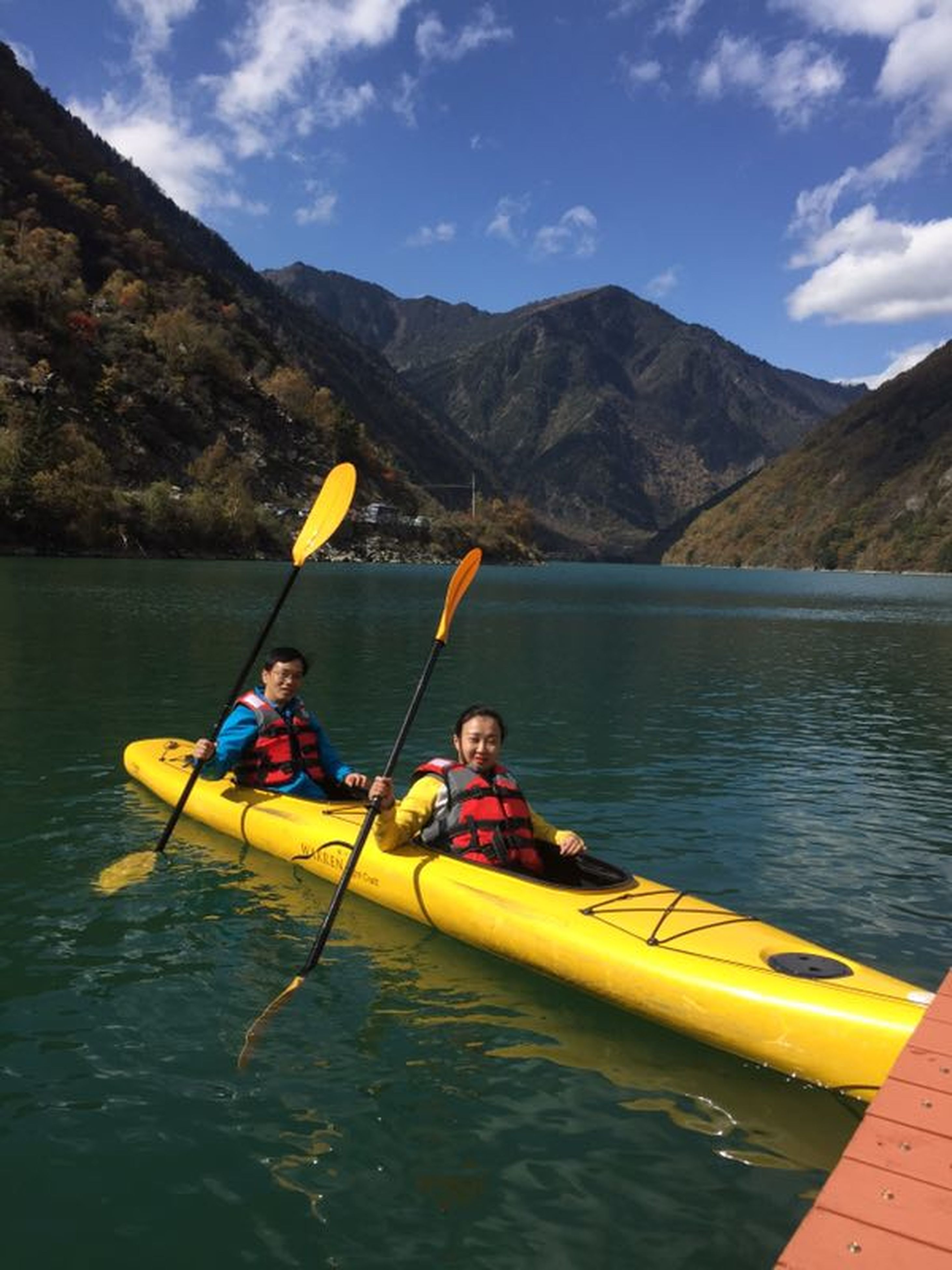 two people, child, kayak, lake, oar, mountain, mature adult, togetherness, girls, life jacket, vacations, people, family, mountain range, adventure, full length, nautical vessel, adult, mature women, canoe, bonding, aquatic sport, mature couple, sports clothing, rowing, outdoor pursuit, childhood, water, nature, outdoors, day