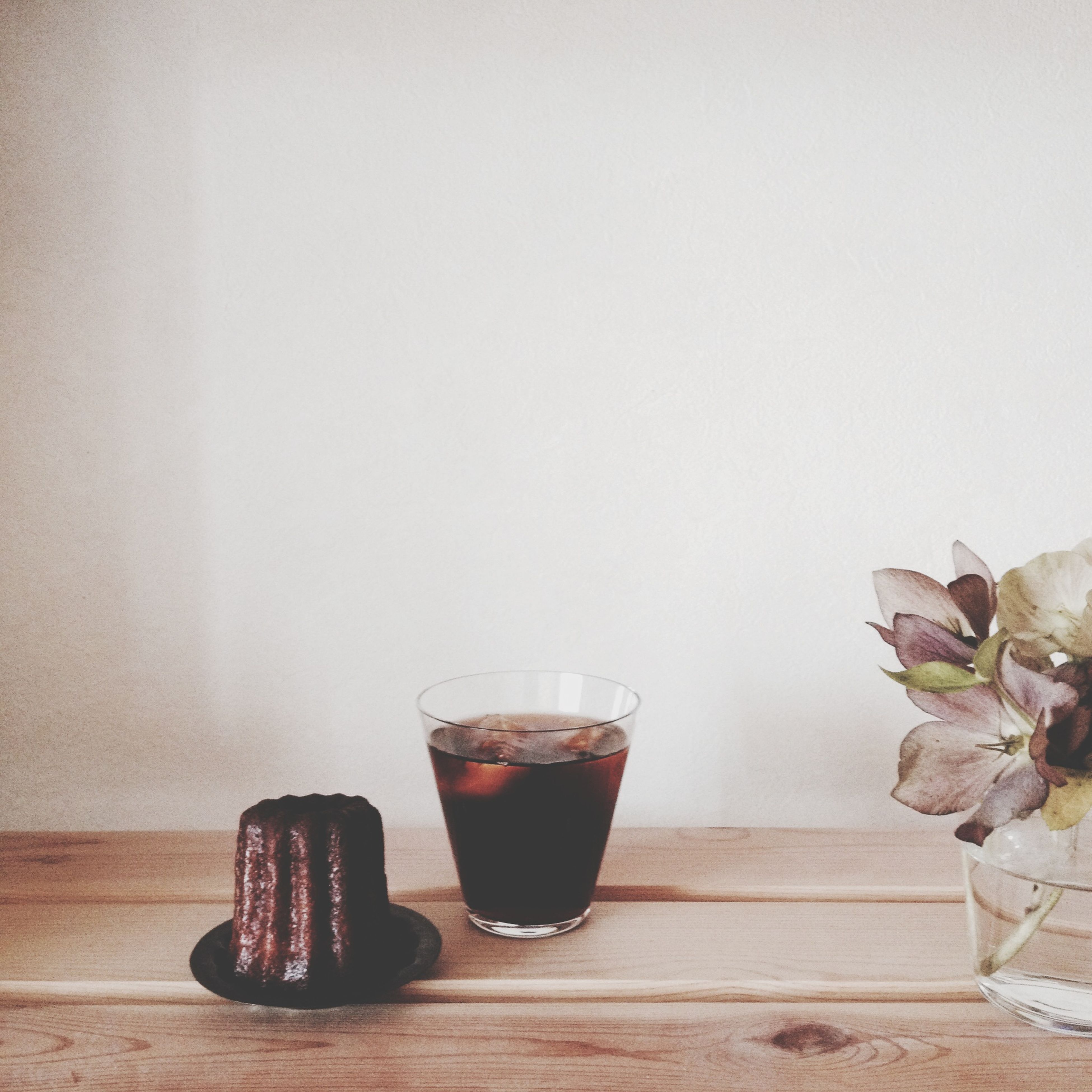 table, indoors, still life, wall - building feature, freshness, food and drink, potted plant, vase, wood - material, copy space, close-up, glass - material, no people, home interior, drinking glass, jar, bottle, leaf, wall, drink