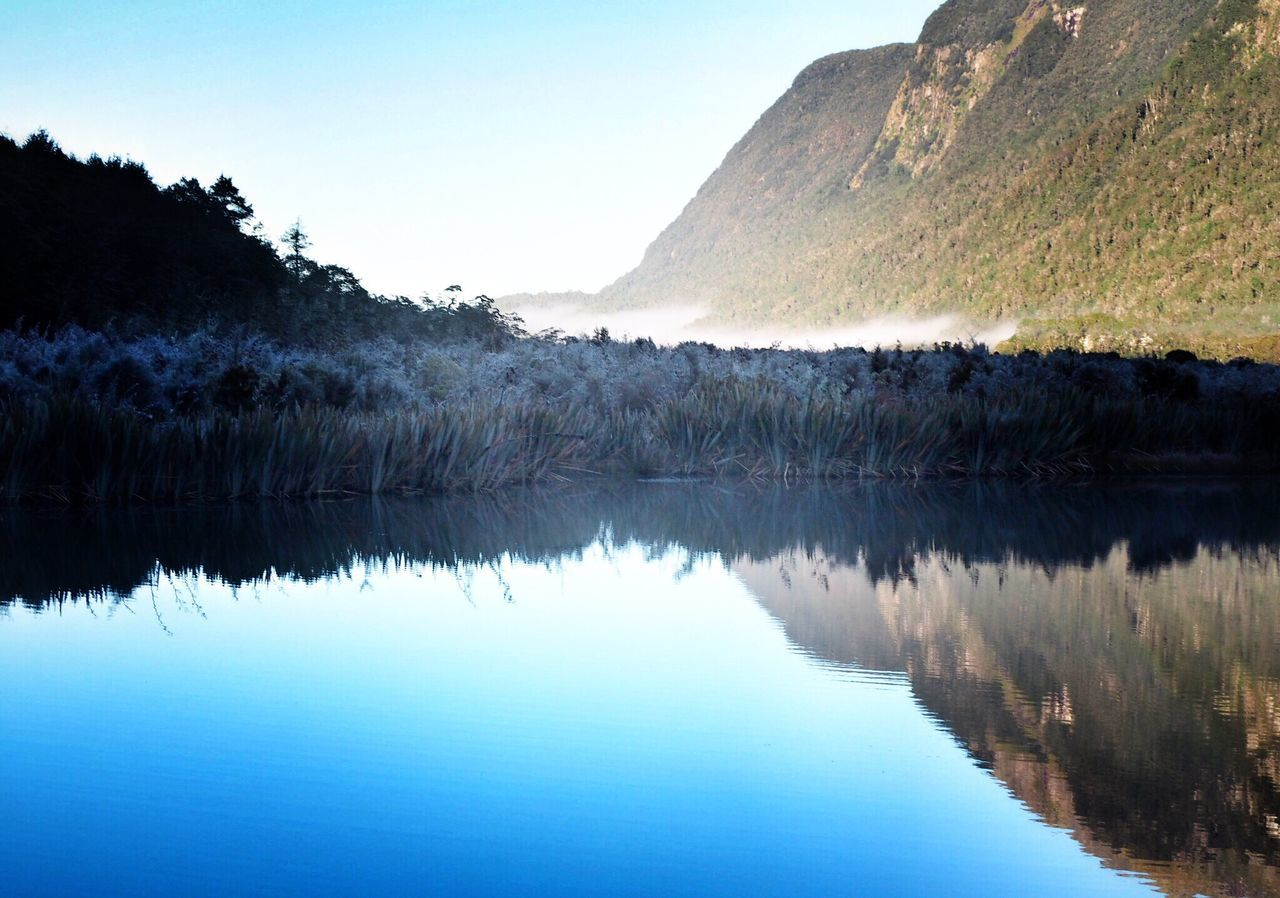 Reflection Mirror Mirror Lake Scenics Tranquil Scene Mountain Beauty In Nature New Zealand Tranquility No People Lake Outdoors Landscape Peace Clear Water Dividing Line Nature National Park Milford Sound