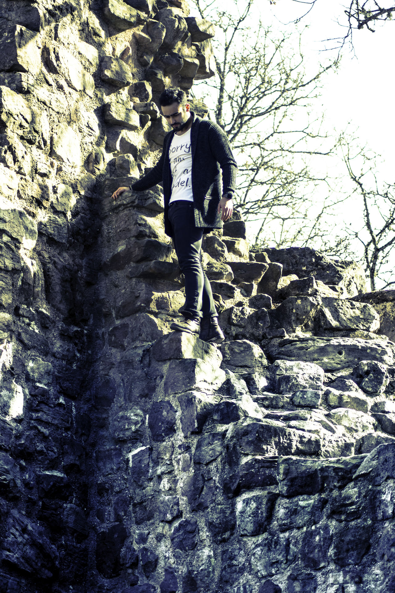 Cold Day EyeEm Best Shots Full Length Leisure Activity Lifestyles Low Angle View Men Model Nature One Person Outdoors Real People Rear View Rocks Shooting Standing Tree Wall