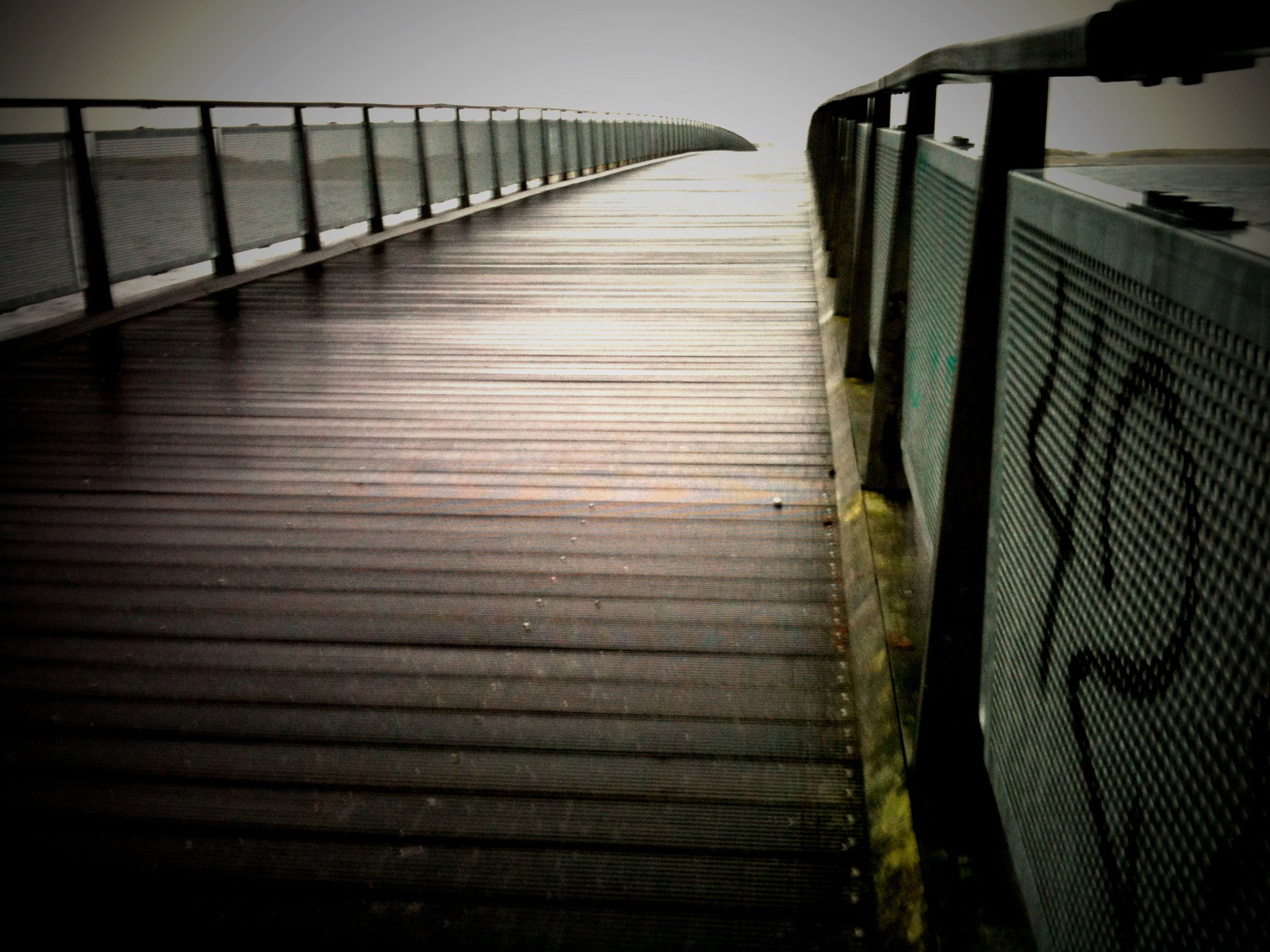 wood - material, wooden, wood, railing, plank, boardwalk, the way forward, built structure, pier, sunlight, nature, fence, no people, day, sky, outdoors, sea, diminishing perspective, close-up, tranquility
