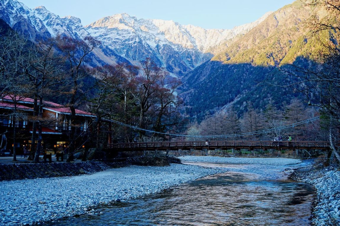 """Seeing The Sights Here is called """" Japanese Yosemite Valley """" So famous place. EyeEm Nature Lover Mountain View BrigeWood Wildlife & Nature Landmark EyeEm Best Shots - Landscape International Landmark Blue Sky Snow River Collection Beautufulwiew Mountain Hiking River Walk Taking Photo at Kamikochi in Nagano Prefecture Japan 11月初めの上高地です。 Adapted To The City"""