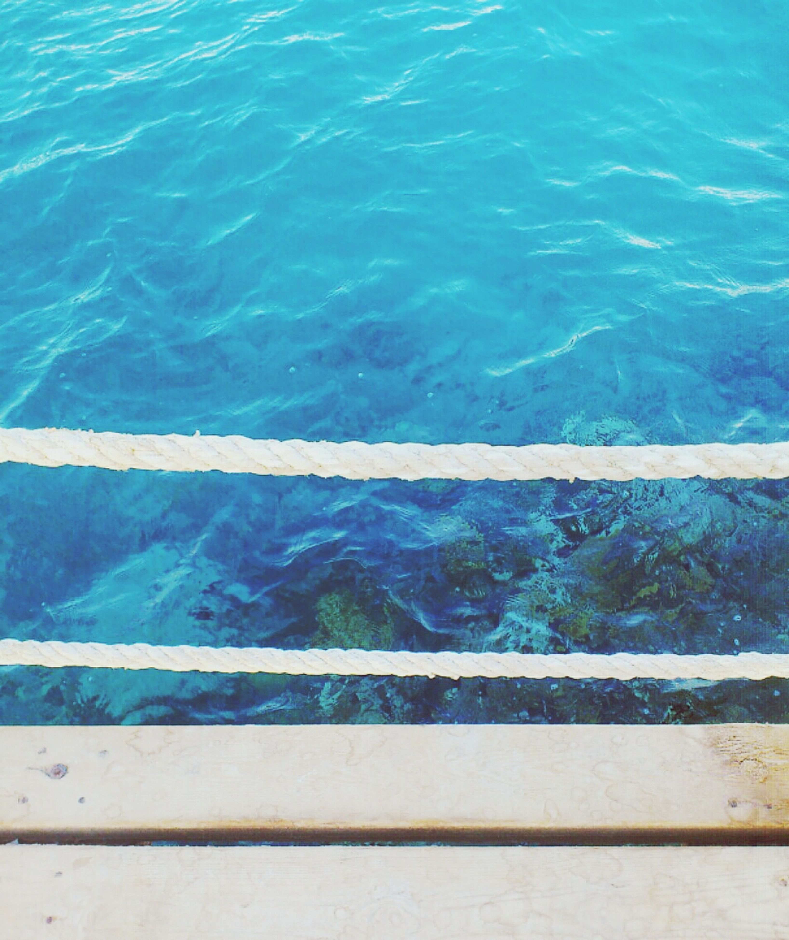water, blue, high angle view, sea, lake, railing, nature, swimming pool, rippled, turquoise colored, beauty in nature, waterfront, day, tranquility, river, outdoors, no people, scenics, tranquil scene, elevated view