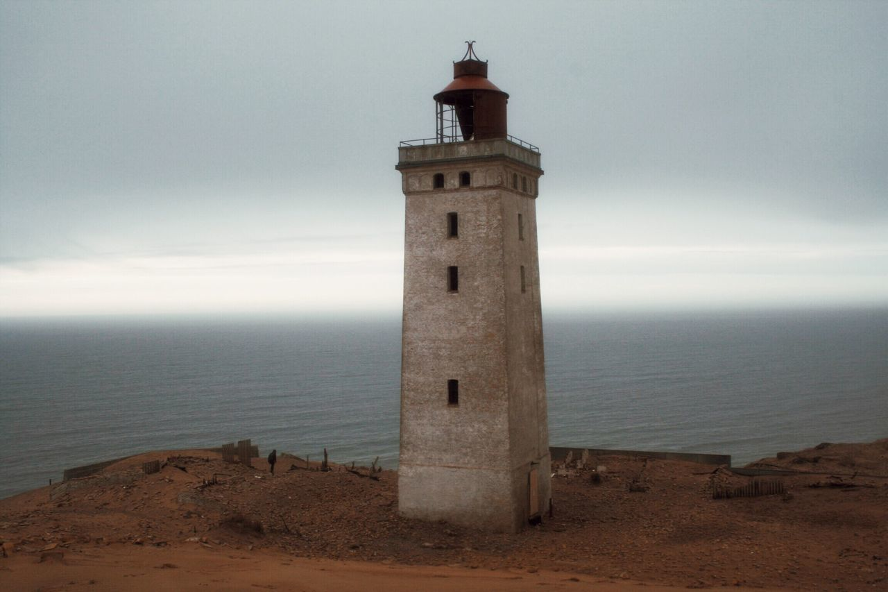 The Lighthouse on the edge in Rubjerg Knude uncovered from the sands of the wandering Dunes - Sea Lighthouse Horizon Over Water Architecture Guidance Protection Built Structure Building Exterior Tower Outdoors Sky Nature No People Water Scenics Tranquility Day Beach Beauty In Nature Jutland Danmark Seaside