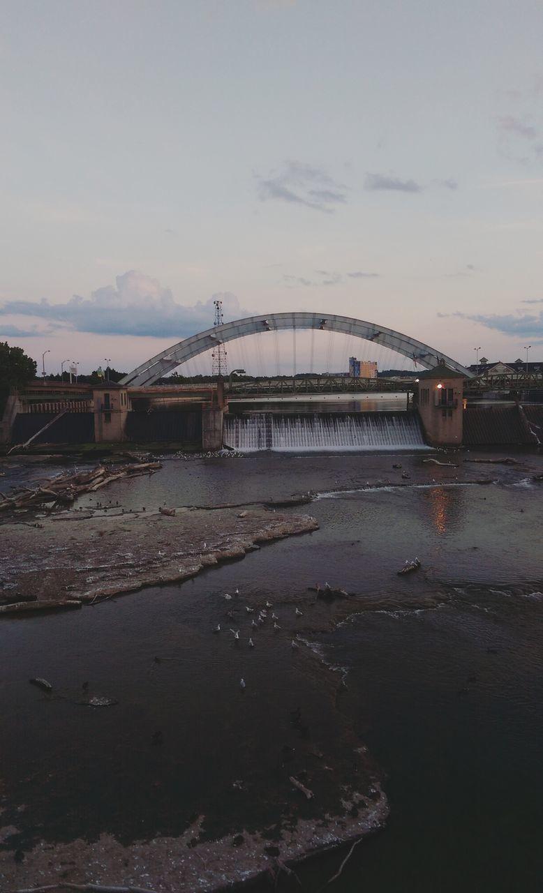 Bridge Over Dam Against Sky