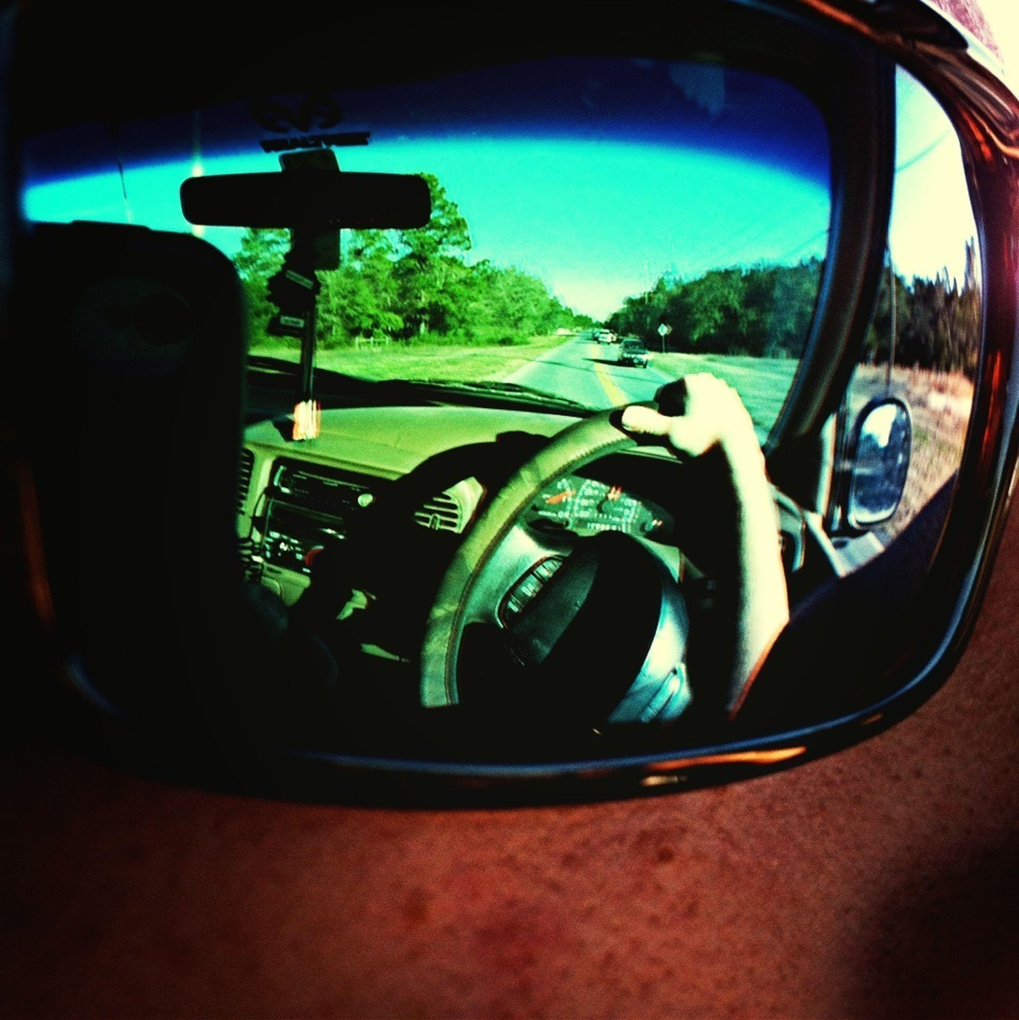 land vehicle, mode of transport, transportation, car, vehicle interior, side-view mirror, reflection, glass - material, car interior, window, transparent, travel, close-up, indoors, windshield, sunlight, photography themes, part of