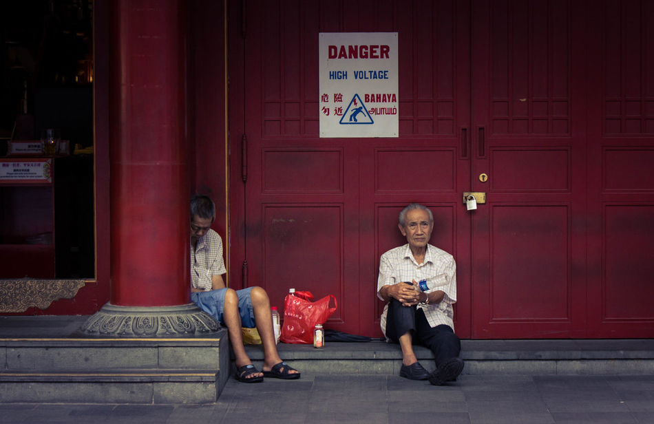 Bored Chinese Style Chinese Style Building City Life Doors Old Men Outdoors Red Red Doors Street Life Street Photography Chinatown Chinatown Singapore People And Places