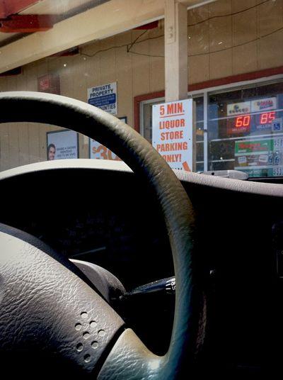 Parked truck Truck Interior liquor store Parking Lot Parking Spot through the window Sign