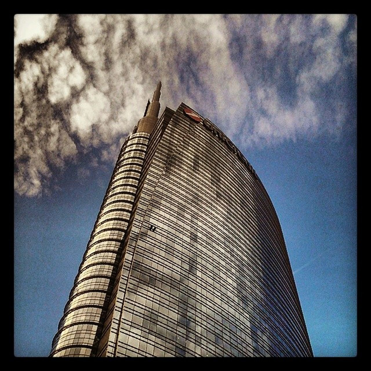 architecture, built structure, low angle view, sky, building exterior, modern, skyscraper, day, cloud - sky, no people, outdoors, travel destinations