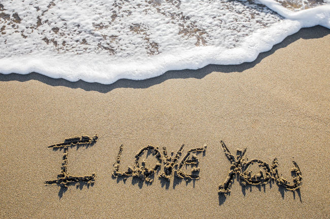 Love sculpted in the sand Abstract Beach Designed Existential  Grunge Heart Inspirational Life Love, Motivation Phrase Sand Sculpted Sea Text Texture Together Water Wave Writing