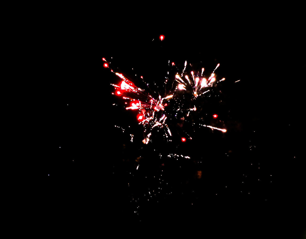 celebration, firework display, night, firework - man made object, exploding, arts culture and entertainment, event, motion, low angle view, long exposure, glowing, outdoors, no people, blurred motion, firework, red, illuminated, clear sky, multi colored, sky, high