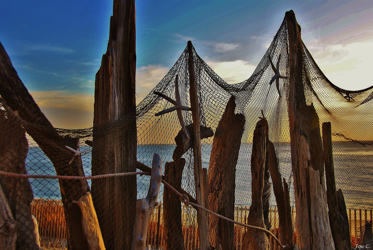 Scenic ocean driftwood netting view Driftwood Netting No People Ocean Outdoors Scenic Sky Sunset