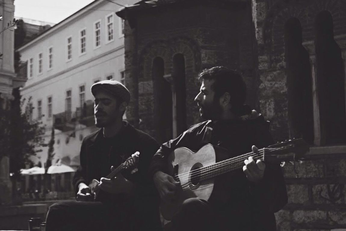 Two musicians playing traditional rebetiko in front of the historical Kapnikarea church in Athens Monastiraki. Music Musical Instrument Two People Musician Guitar Real People Arts Culture And Entertainment Athens Busking Kapnikarea Photooftheday Blackandwhite Architecture Eyekonique Greece Street EyeEm Gallery Eyemphotography EyeEmNewHere Eyem Best Shots EyeEm Best Shots Documentary Streetphoto_bw Street Photography The Secret Spaces EyeEmNewHere The Street Photographer - 2017 EyeEm Awards