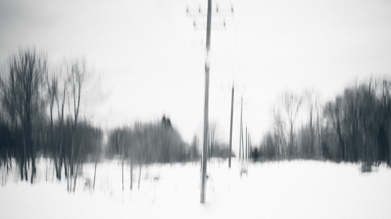 Artistic Blurry Forest Parking Lot Poles Snow Scene  Snow Storm Trees Winter Showing Imperfection