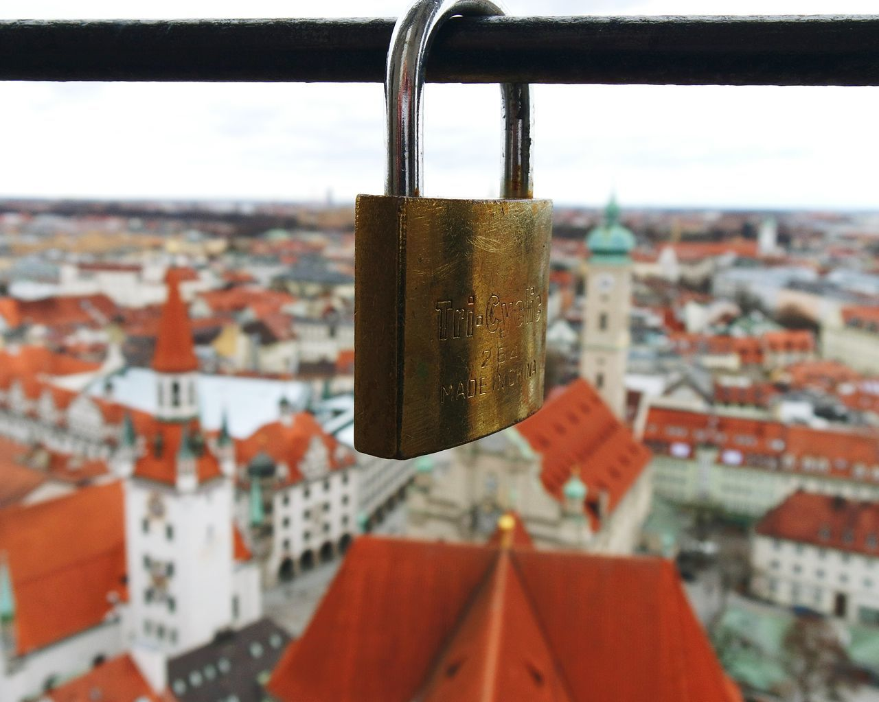 lovelock at the belltower of st.peterchurch in Munich Focus On Foreground City Padlock Hanging Sky Building Exterior Close-up Love Lock No People Cityscape Architecture Outdoors Day Lock