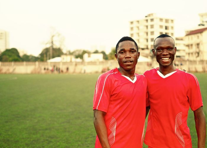 African Boys Simba Sports Club Simba Soccer Players Football Players Football Friends Natron Studios Rutagwerela Paschal Rutagwerela Dar Es Salaam Tanzania Smilling Africans African Soccer Players Portrait Teamwork Two People Sports Uniform Healthy Lifestyle Looking At Camera Red Togetherness Athlete Men Friendship Soccer Player Sports Team Sportsman Smiling
