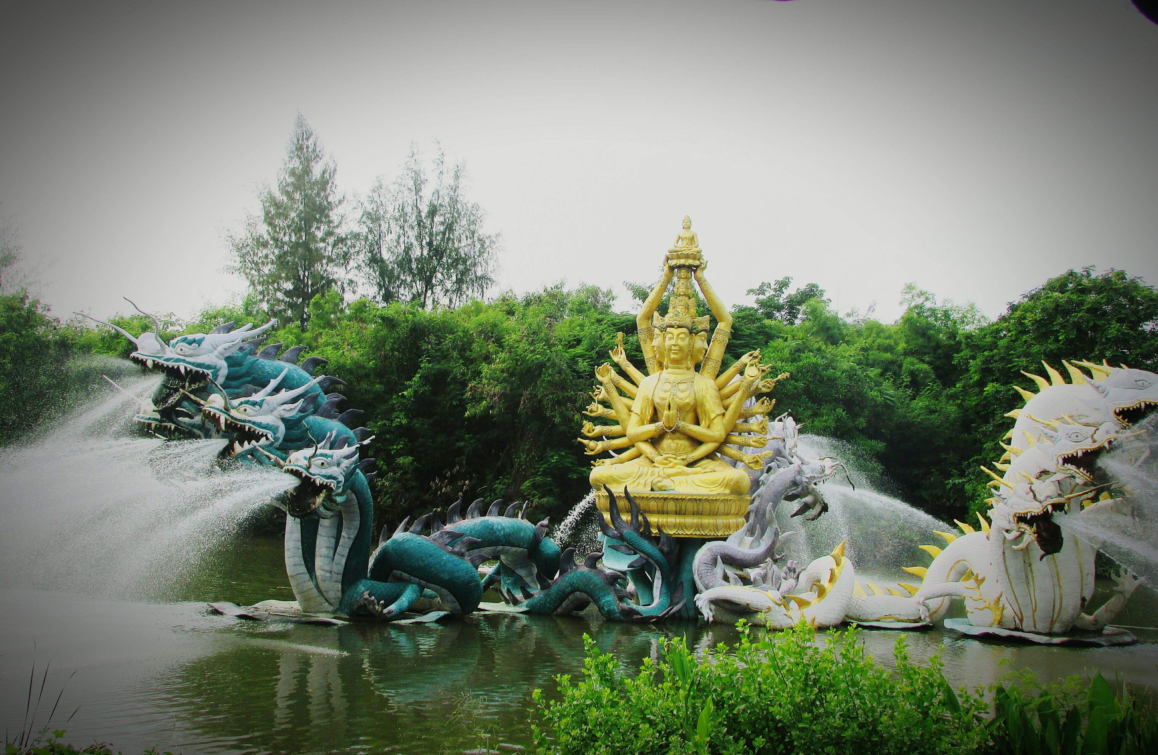 Watch This Out Water Statue Art And Craft Stone - Object Fountain Waterfront Outdoors Scenics Garden Clear Sky Vacations Relaxing In Thailand