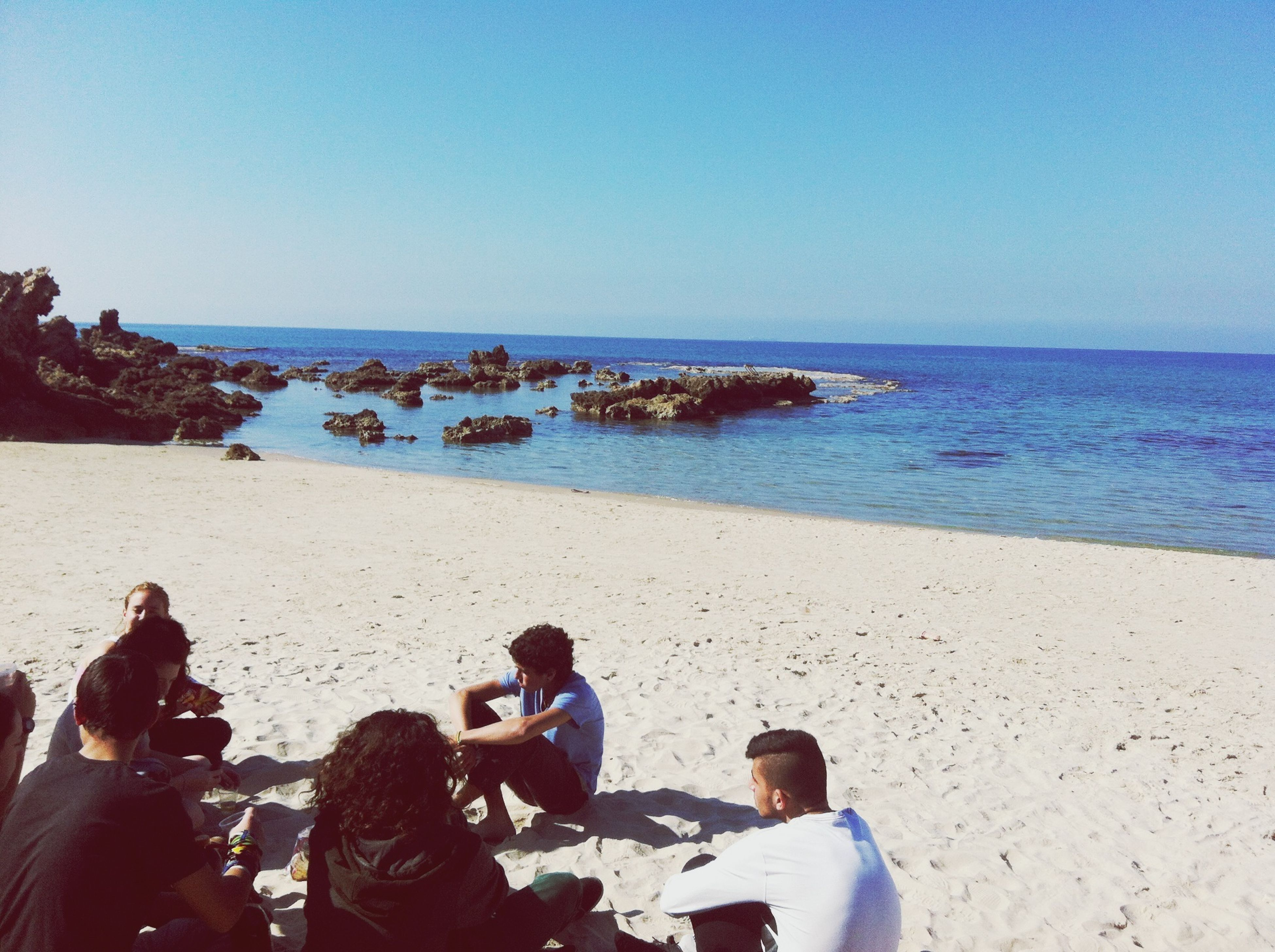 sea, horizon over water, water, beach, clear sky, shore, lifestyles, copy space, leisure activity, scenics, beauty in nature, vacations, tranquility, tranquil scene, blue, nature, men, sand, person