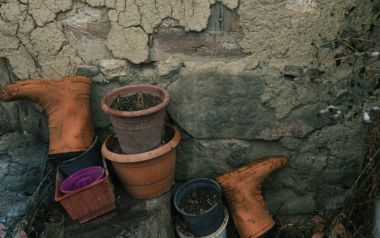 Snowy Village Life Cold Temperature Concrete Wall Equipment Flower Pots High Angle View Nature Outdoors Paint Can Rain Boots Rubber Boots Snowing Snowy Stone Wall Sünnet Sünnetköy Turkey View Village Life Wall Winter